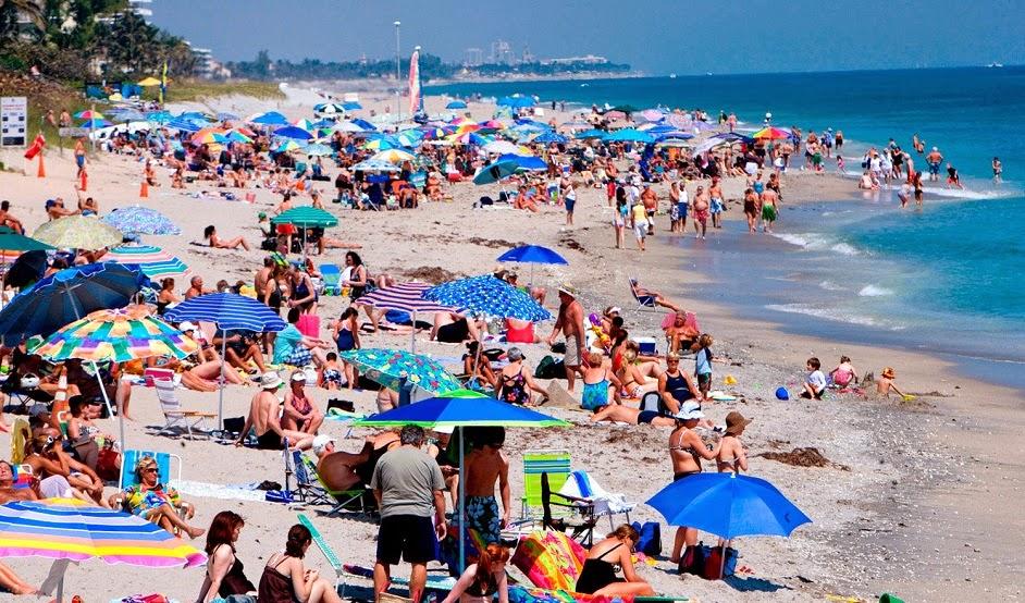 Visitantes en playa de Miami - Mejores meses y épocas para ir a Miami